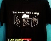 You know he's lying t-shirt   (Extended sizes - 2X-5X)