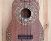 Hand painted mahogany soprano ukulele.