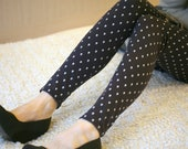 Dark blue polka dot leggings with skulls