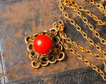 Vintage necklace,  gold plated filigree pendant, with red glass stone