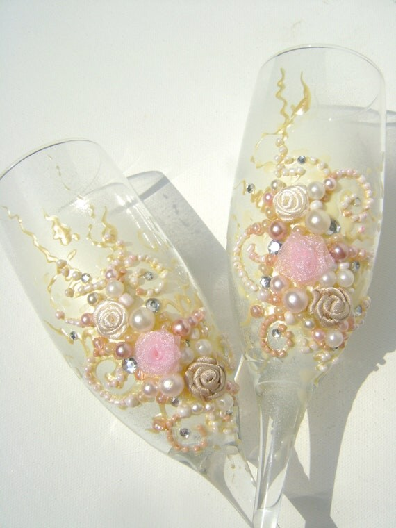Beautiful wedding champagne glasses in light pink, ivory and champagne, with a touch of silver crystals