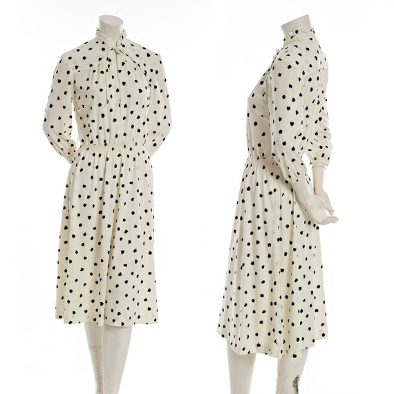 Vintage cream dress with tear-shaped polka dots and ruffle collar, tie at neck