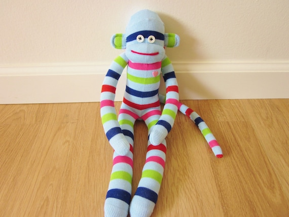 Striped sock monkey plush doll - light blue, red, pink, lime green, and navy blue