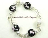 Silver Bracelet of Black & Pink Lampwork Glass Beads