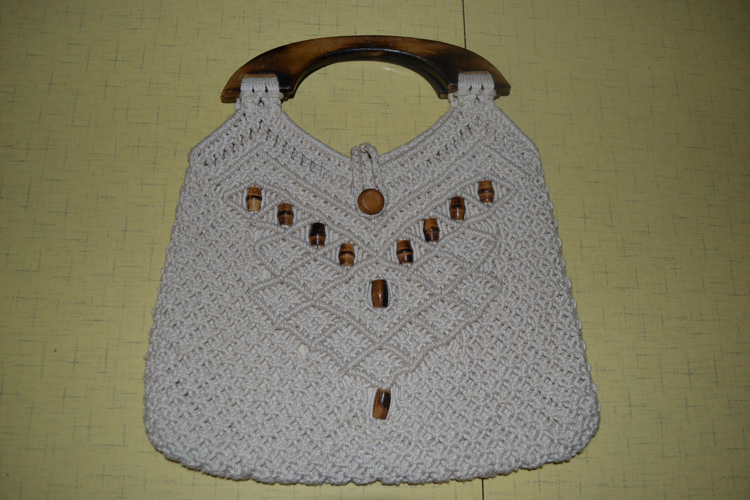 Cream Colored Macrame Purse With Wooden Handles And Bead