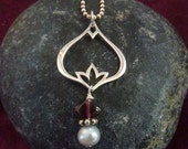 Flower charm pendant with garnet and pearl stone