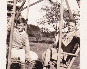 Vintage B&W Photo of two men, enjoying a swing.