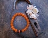 Tangerine Jade Yoga Stretch Bracelet with Sandalwood Bead