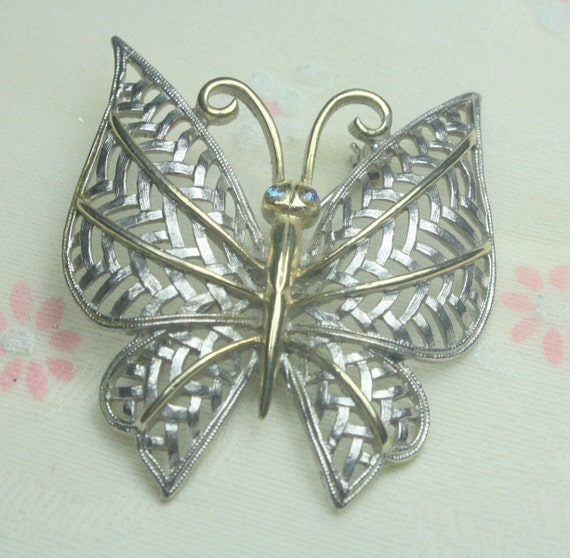 Vintage Silver and Gold TOne Metal Avon  Butterfly Brooch with Blue Rhinestone Eyes
