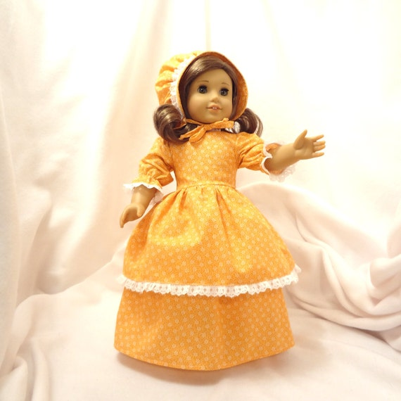 Tangerine orange and white print, long dress for 18 inch dolls, double-skirted, with white lace trim.