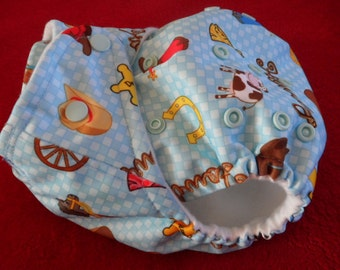 SassyCloth one size pocket diaper with howdy cowboy PUL print. Made to order.