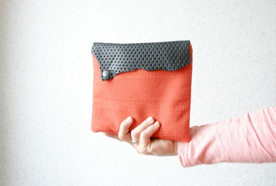 Clutch bag in orange vintage fabric  with leather flap in black