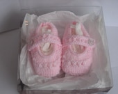 hand knitted little princess shoes in baby pink