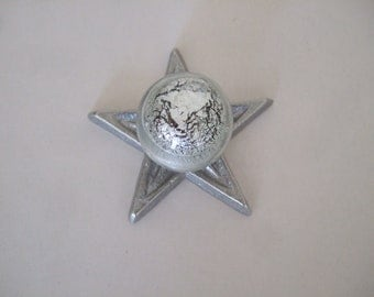 Glass knob on aluminum star back plate
