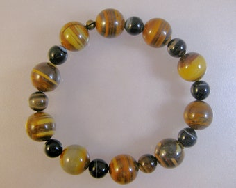 Jupiter jasper and banded black agate stretch bracelet: charity donation