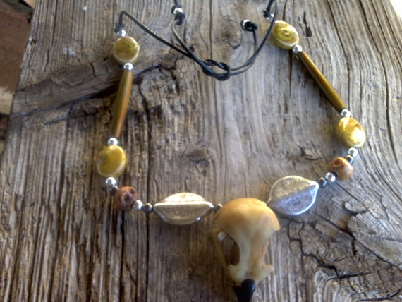 2 1/2 inch resin eagle skull,porcelian,silver ,bone beads on leather adjustable size