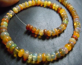 Ethiopian Opal Smooth Rondelle BeadsAAA Quality 10''  Size 5MM To 6MM MM Wholesale Price
