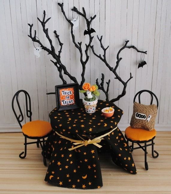 "Miniature Halloween Scene With Black And Orange Table And Chairs, Tree With Hanging Ghosts And Bats, Burlap ""OOOO"" Pillow, And More"