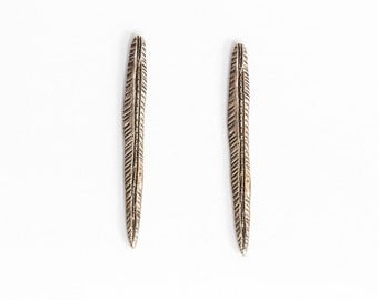 Golden spear earrings
