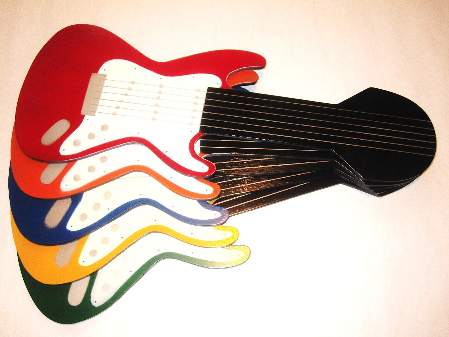 Multi-colored electric guitar shaped ceiling fan blades
