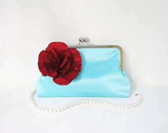 Blue Clutch Purse with Red Flower Adornment