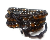Chan luu inspired beaded leather wrap bracelet .Natural Tiger eye stone on brown leather three wrap bracelet.