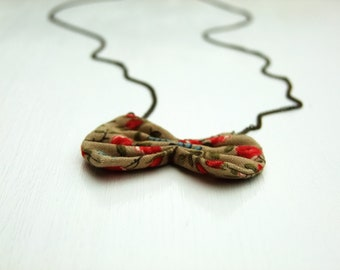 Tan red blue floral fabric bow, long antique gold chain