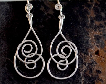 """Sterling silver spiral earrings. Silver dangle earrings.  hand forged.  """"whirlwind"""""""