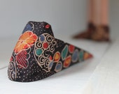 A colorful handmade door stopper