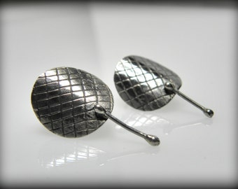 round silver stud earrings are modern jewelry with patina and mesh texture