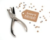 Happy Birthday Tags . Gift Wrap Supplies . Modern Calligraphy and Handwritten Capitals . White Ink on Brown Kraft . Set of 10