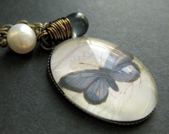 Butterfly Necklace. Blue Butterfly Charm Necklace with Dusky Blue Teardrop and Pearl. Handmade Jewelry.