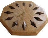 Wood Clock.  Wooden hanging wall clock with oak trim and rustic walnut.