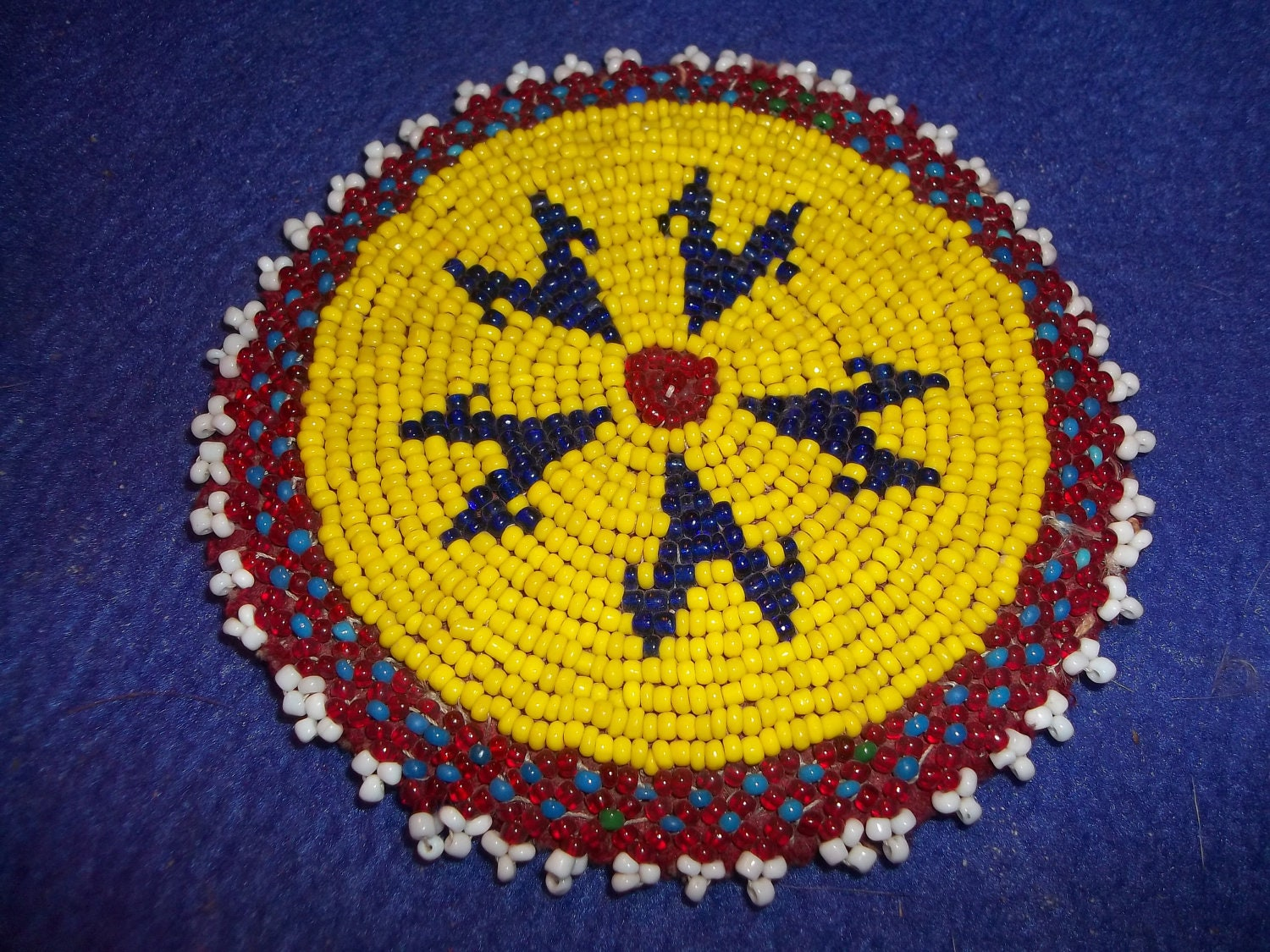 made beaded rosette american indian pow wow