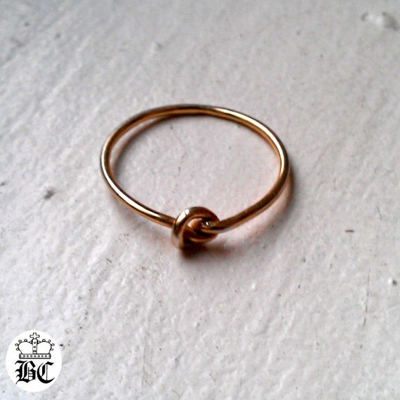 stack promise knot ring gold plated above the knuckle midi