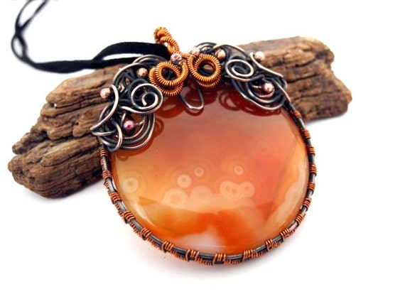 Copper pendant with lace Agate in halloween orange and black, circle round as a pumpkin, with snails swirls curls