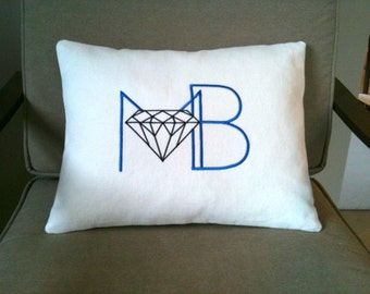 Custom embroidered logo pillow cover with personalised corporate design.