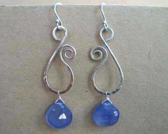 Hammered sterling silver and blue chalcedony abstract swirl earrings. Sterling silver womens earrings with chalcedony faceted pear drops.