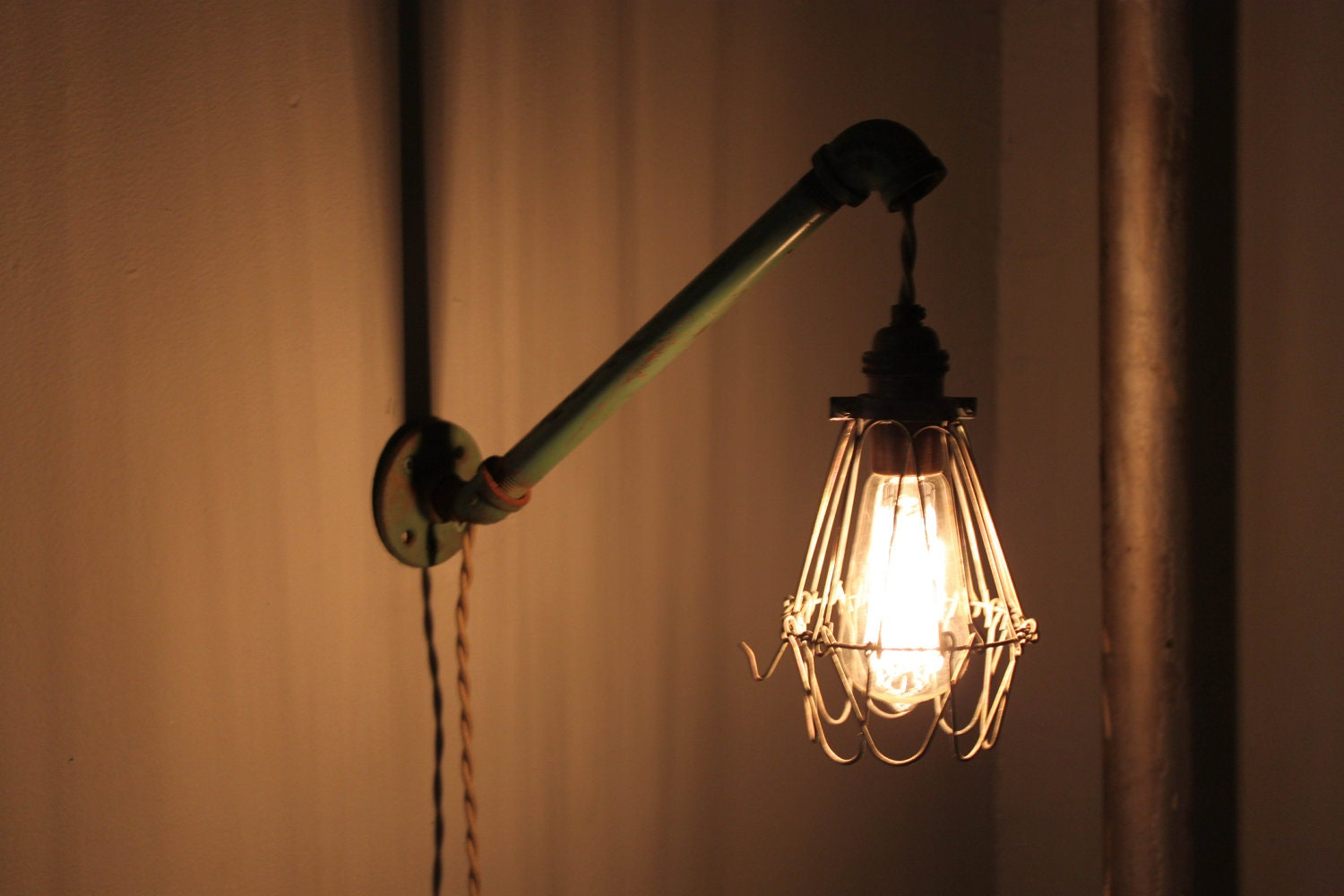 Industrial Wall Light With Cage Bulb