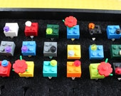 One Lego ring. Lots of colors to choose from. Perfect birthday party favors or wedding favors. Choose your color.