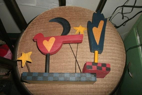 Folk art hand and bird with moon and stars