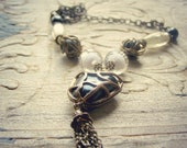 Vintage Boho Necklace, Glass beads, Metal heart Pendant Necklace, brown black and white rustic Necklace