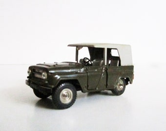 VINTAGE metal Soviet CAR. Use for mixed media art, photography projects, assemblage, etc.