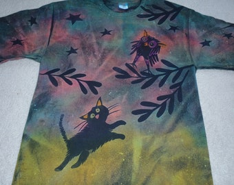 Owl and kitty design with stars and leaves in turquoise, pink, greens and grape on a man's large discharge t-shirt with procion dyes