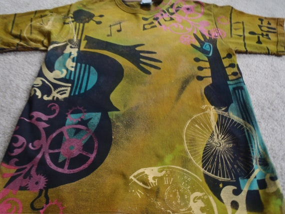 Discharged, dyed and silk screened man's medium t-shirt, guitars, hands, gears,pocket watches, and bicycles