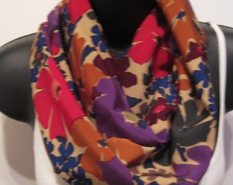 New Floral Infinity Scarf. Red, Orange, Blue, Green, Purple Flowers with a Tan Background
