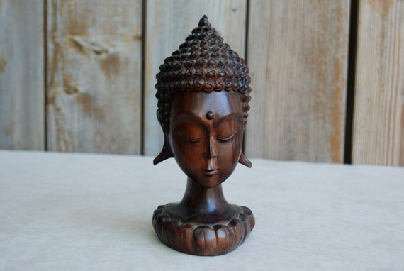 Wooden carved buddha head