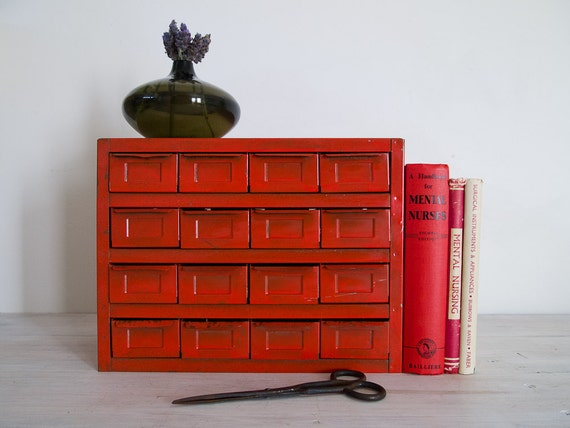 vintage industrial cherry red metal storage cabinet with 16 drawers