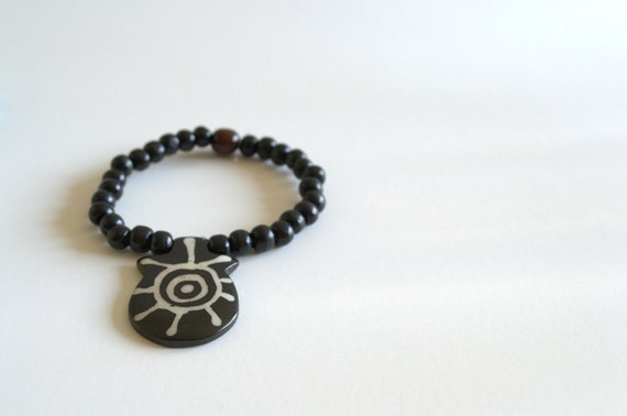 Black Wooden Bead Bracelet with Large Tribal Charm