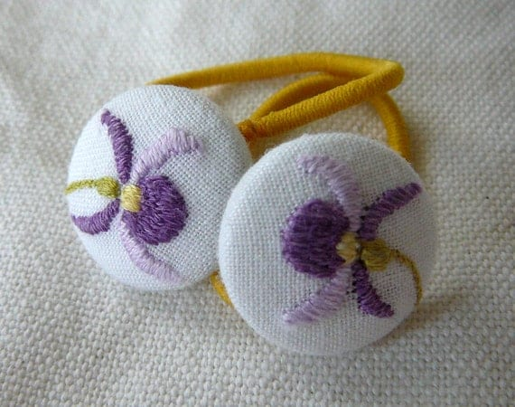 Pig tail elastics with embroidery covered buttons